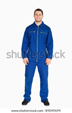 Young mechanic in boiler suit against a white background - stock photo