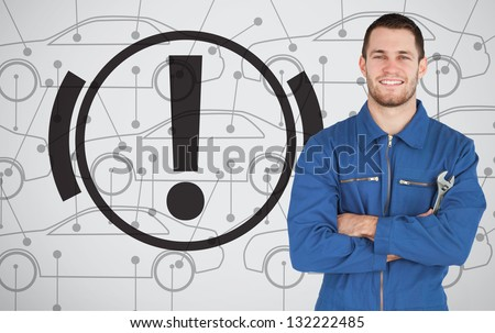 Young mechanic standing next to parking break signal - stock photo