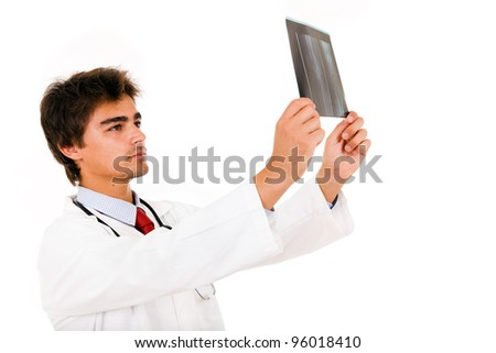 Young medical doctor analyses an x-ray, isolated on white. - stock photo