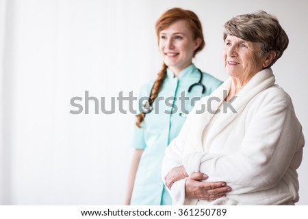 Young medical doctor and elderly female patient