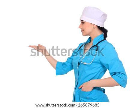 Young medical doctor woman presenting and showing copy space for product or text. Caucasian female medical professional isolated on white background. - stock photo