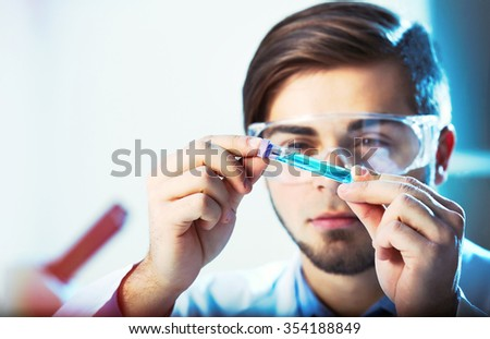 Young medical technician working in laboratory - stock photo