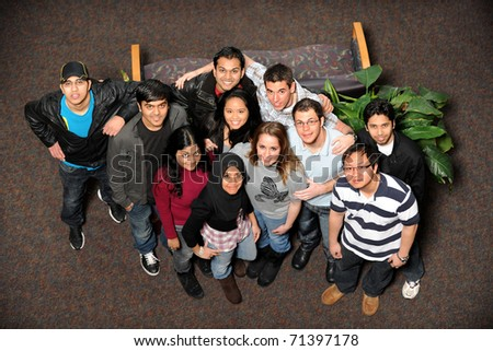 Young men and women of diverse ethnic groups standing together - stock photo