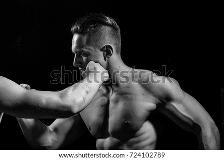 Young men boxing with sexy muscular body and bare torso in studio