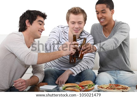 Young men chilling out at home - stock photo