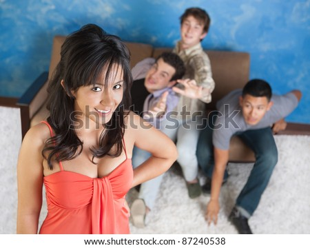 Young men fight over each other behind pretty girl - stock photo
