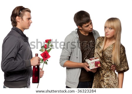 Young  men find out among themselves relations because of the girl. Double appointment. - stock photo