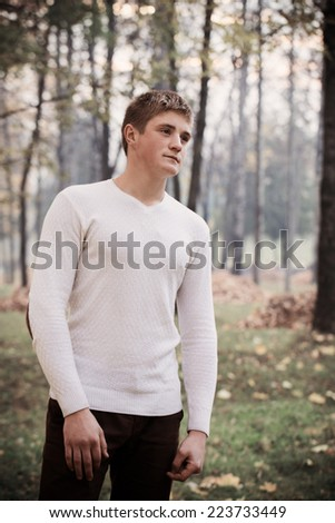 young men in autumn park - stock photo