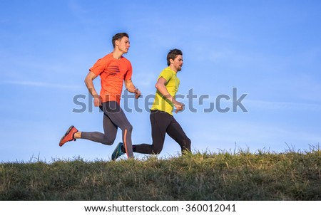 young men jogging in a competition - stock photo