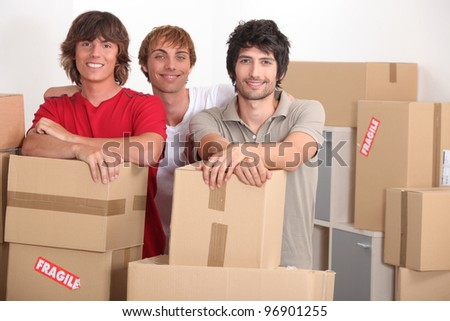 Young men on moving day - stock photo