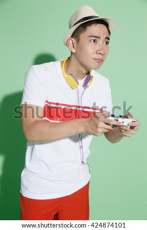 Young men play games - stock photo