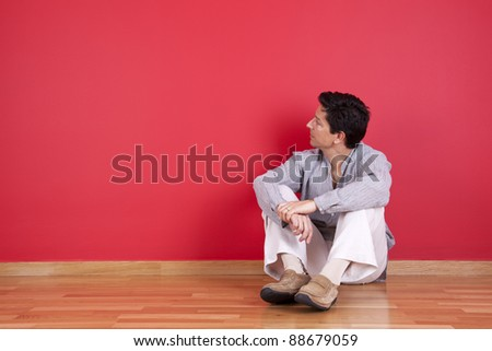 young men relaxing in the floor of his new house - stock photo