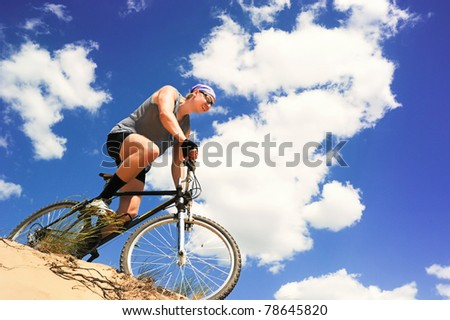 Young men  riding a bike downhill style - stock photo