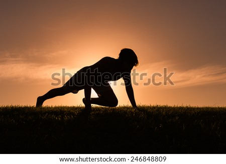 Young men stretching outdoors - stock photo