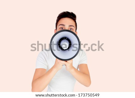 Young men with a megaphone on a pink background - stock photo