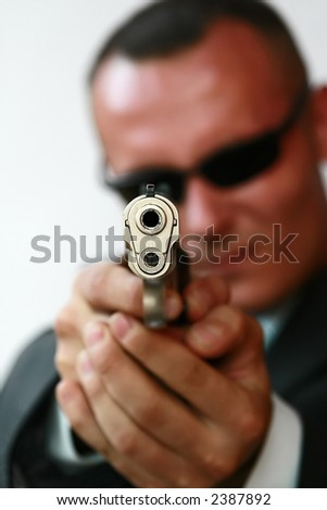 young men with chromed pistol - stock photo