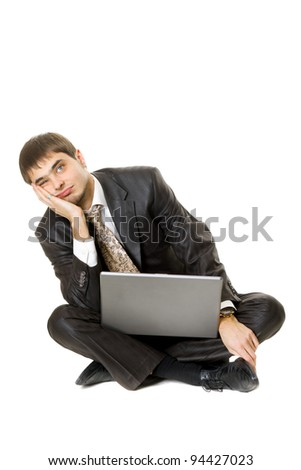 Young men with his laptop with a bored face isolated on white - stock photo