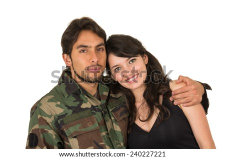young military soldier returns to meet his wife girlfriend happy hugging isolated on white - stock photo