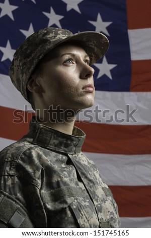 Young military woman pictured in front of US flag, vertical - stock photo