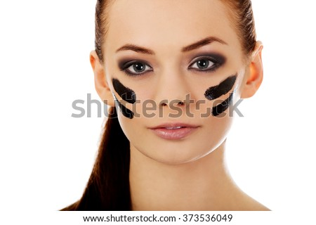 Young military women with war paint on face
