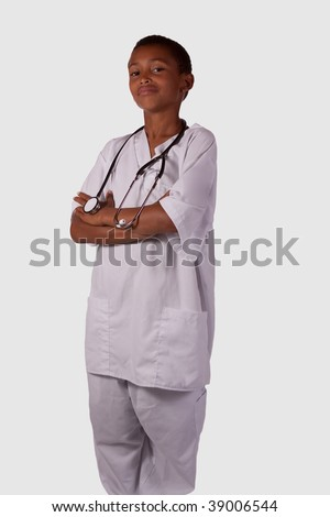 Young mixed race black ethnic boy wearing white scrubs uniform with stethoscope