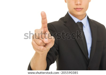 Young mixed race businessman in suit and tie pointing with index finger. Isolated on white background. Unrecognizable person. Selective focus. - stock photo