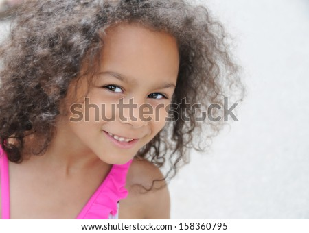young mixed race child smiling , head shot - stock photo