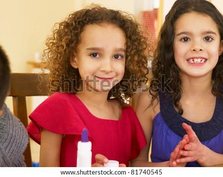 Young mixed race children doing handicrafts - stock photo
