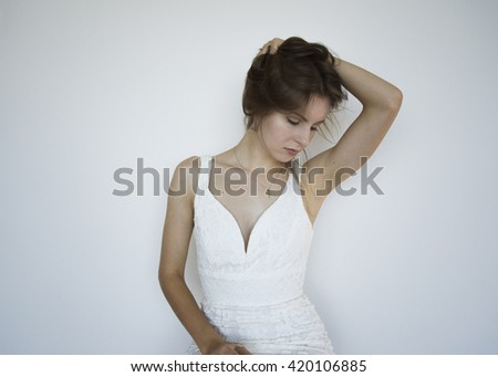 Young model bride posing on a white background
