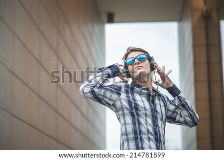 young model handsome blonde man in the city - stock photo