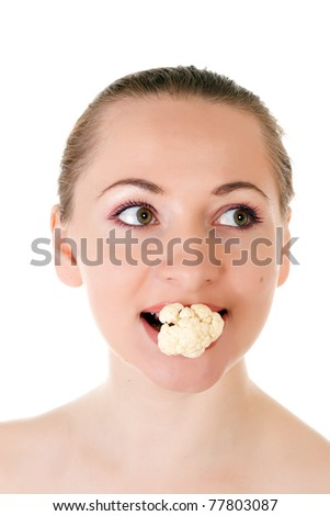 Young model holding batch of cauliflower in her mouth