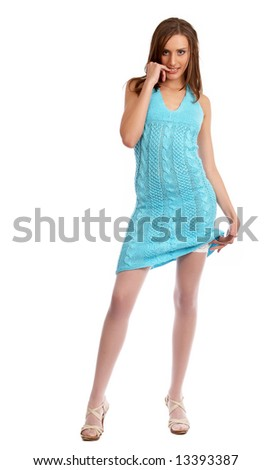young model in a blue dress isolated on a white background