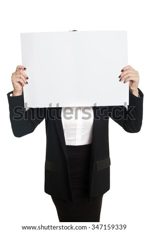 Young model in black suit with white sheet of paper on her face