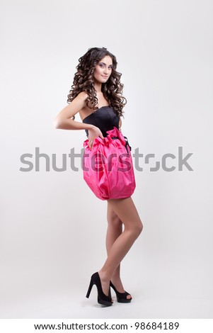 young model in pink mini skirt and black corset posing