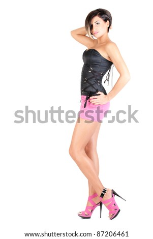 young model in pink mini skirt and black corset posing, isolated on white