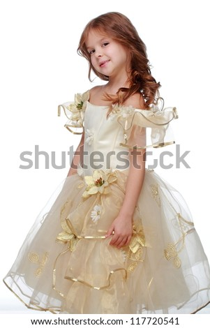 Young model is posing on camera in princess costume on Holiday theme