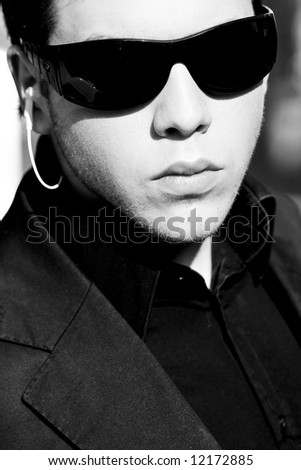 Young model performing security agent - stock photo