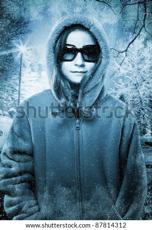 Young Model Poses in Winter Setting - stock photo