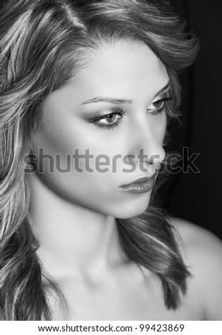 Young model woman face, pretty tall girl posing in studio