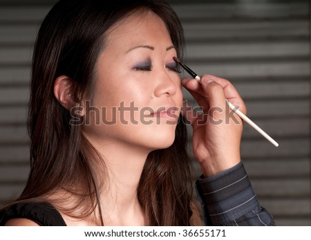 Young model woman getting ready for a runway show. - stock photo