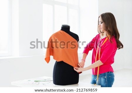 Young modeler in the studio - stock photo