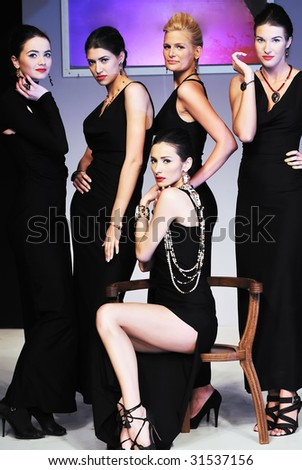 young models group posing on fashion show piste - stock photo