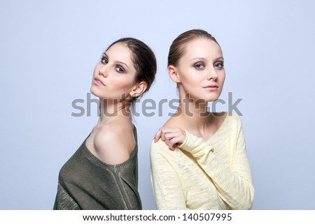 Young models posing in stylish casual clothes - stock photo
