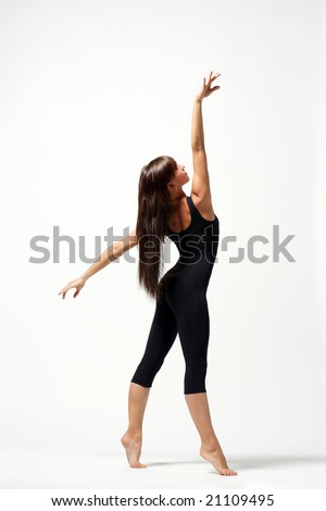 young modern ballet dancer posing on white background