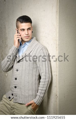 young modern business man with a mobile phone - stock photo