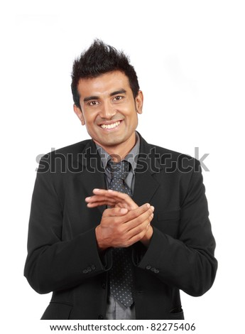 Young modern businessman clapping isolated on white - stock photo