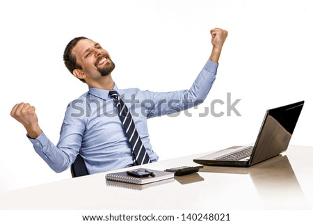 young modern businessman excited with his success while working with his laptop computer  - stock photo