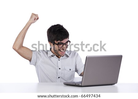 young modern businessman excited with his success with his laptop computer