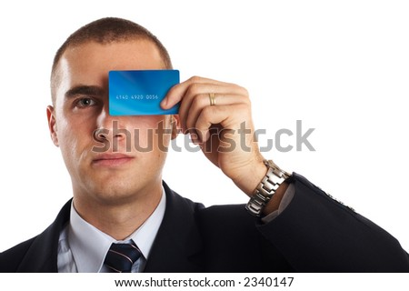 Young Modern Businessman portrait with credit card in front of his face
