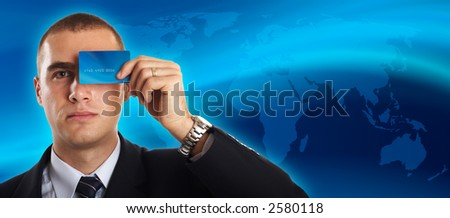 Young Modern Businessman portrait with credit card in front of his face - space for copy